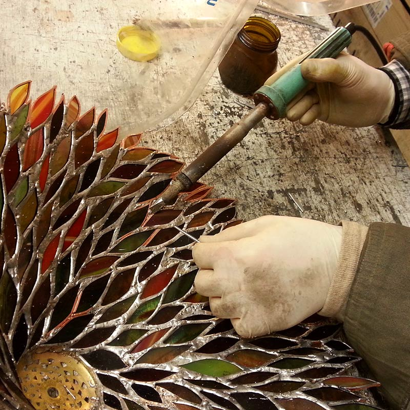 Soldering a stained glass work of art