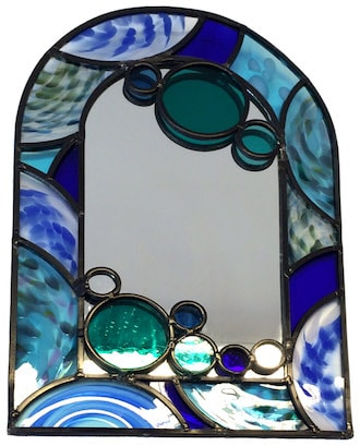 A leaded mirror commission using bath aqau glass hand made roundels