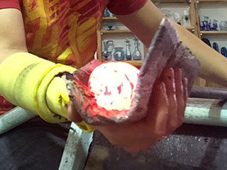 Hand Shaping Molten Coloured Glass Into A Bauble