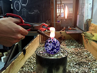 Applying Molten Glass to a Christmas Bauble to Make A Loop