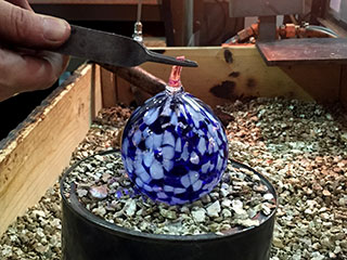 Cutting and Twisting Glass To Form A Hanging Loop